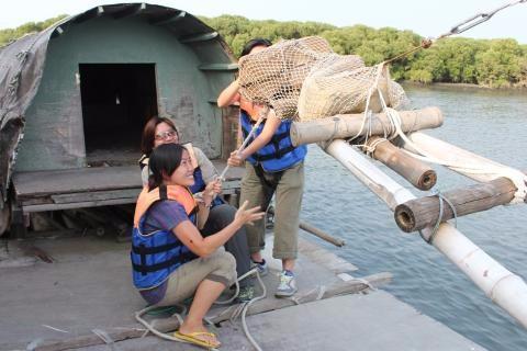 學古人用吊罾補魚