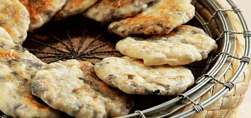 徽州烤餅,梅干菜入肉下去烤到入味,據說是胡適小時候喜歡的徽菜之一。(圖片來源:安徽繁體官網)